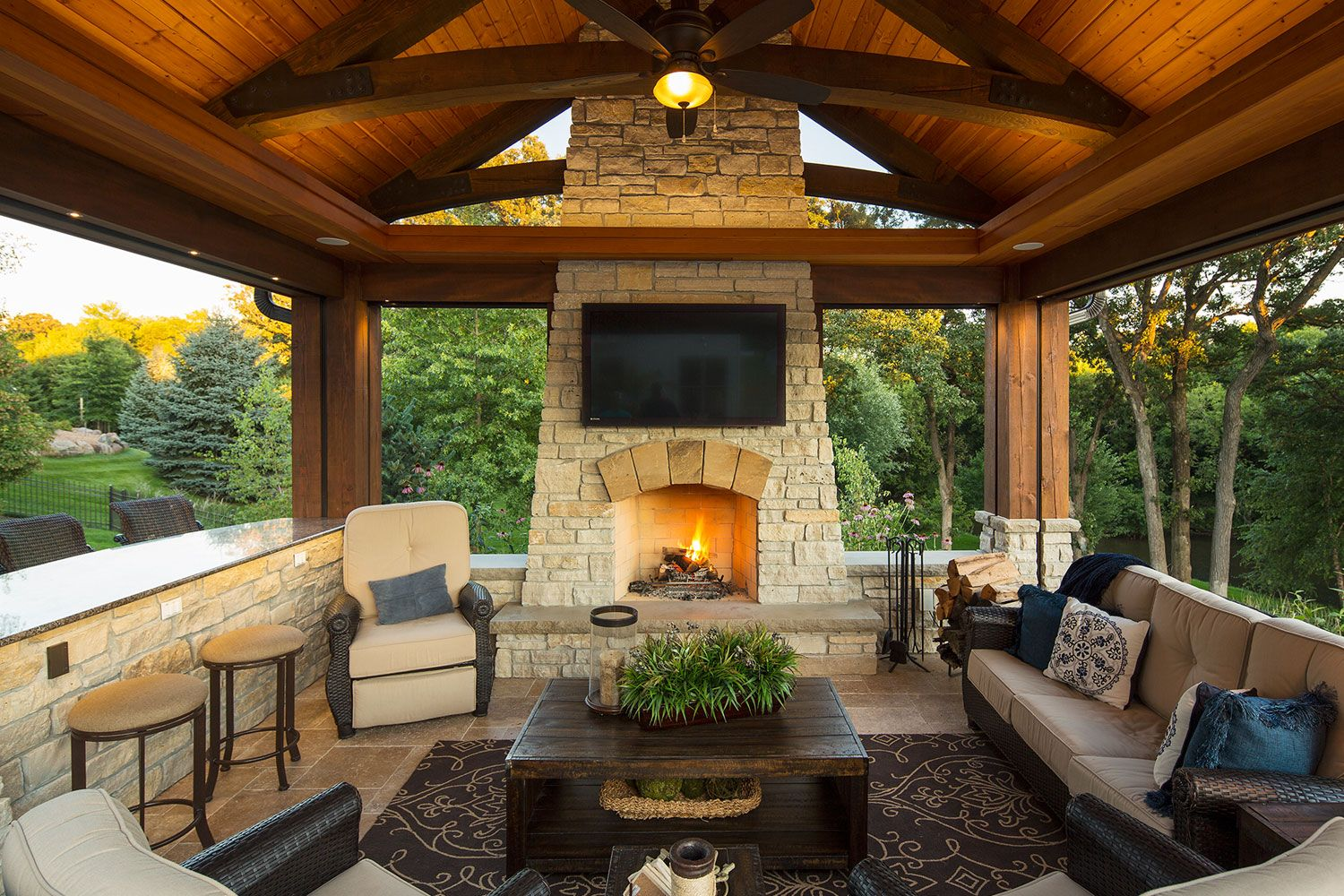 Outdoor Living Room with Stone Fireplace and Travertine
