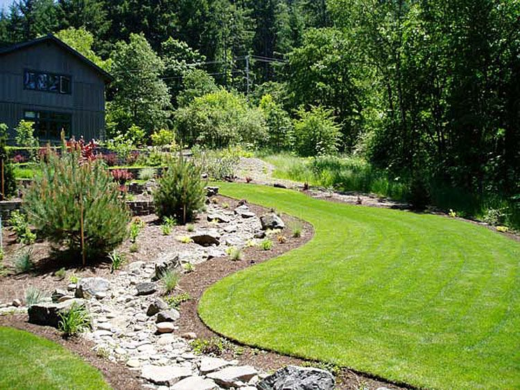 dry stream bed drainage and creek bed installation
