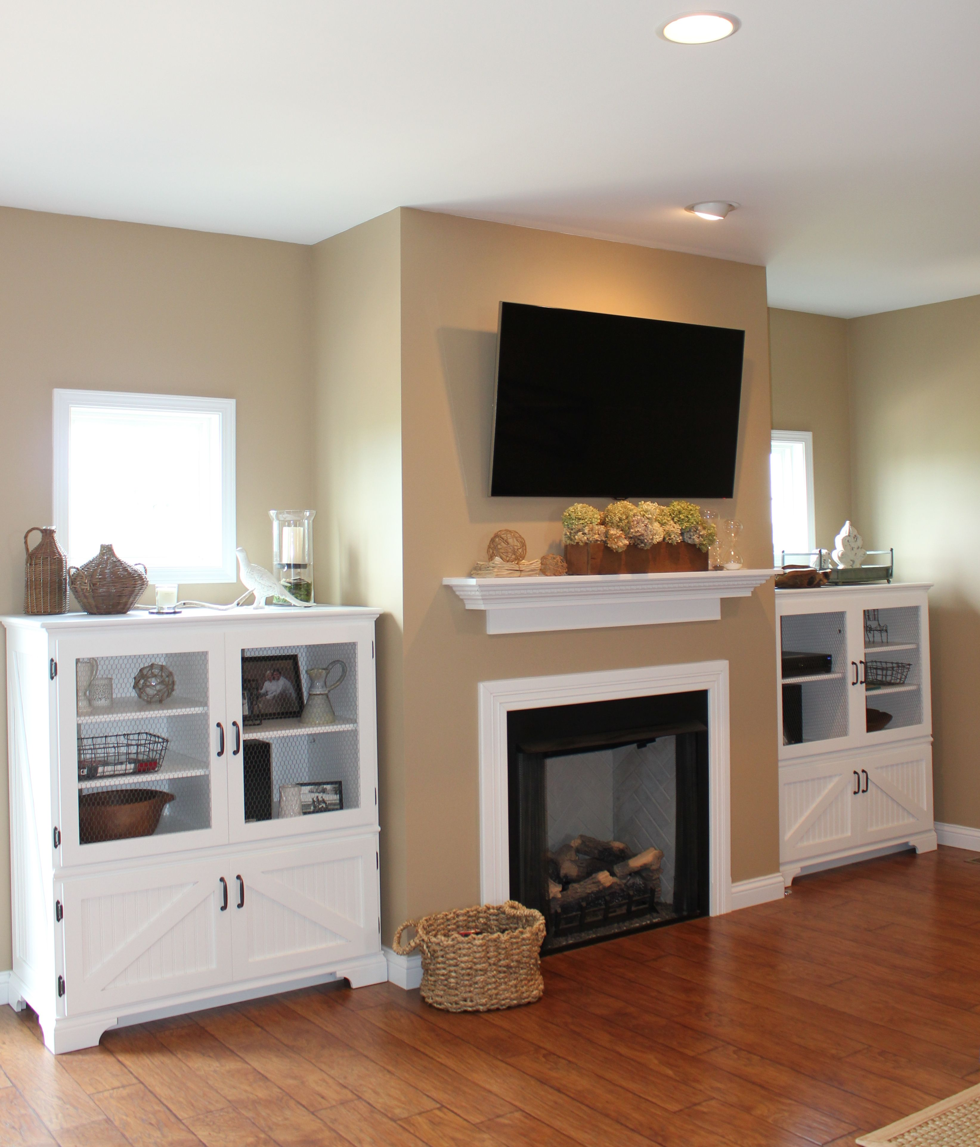 white built ins , fireplace, white cabinets