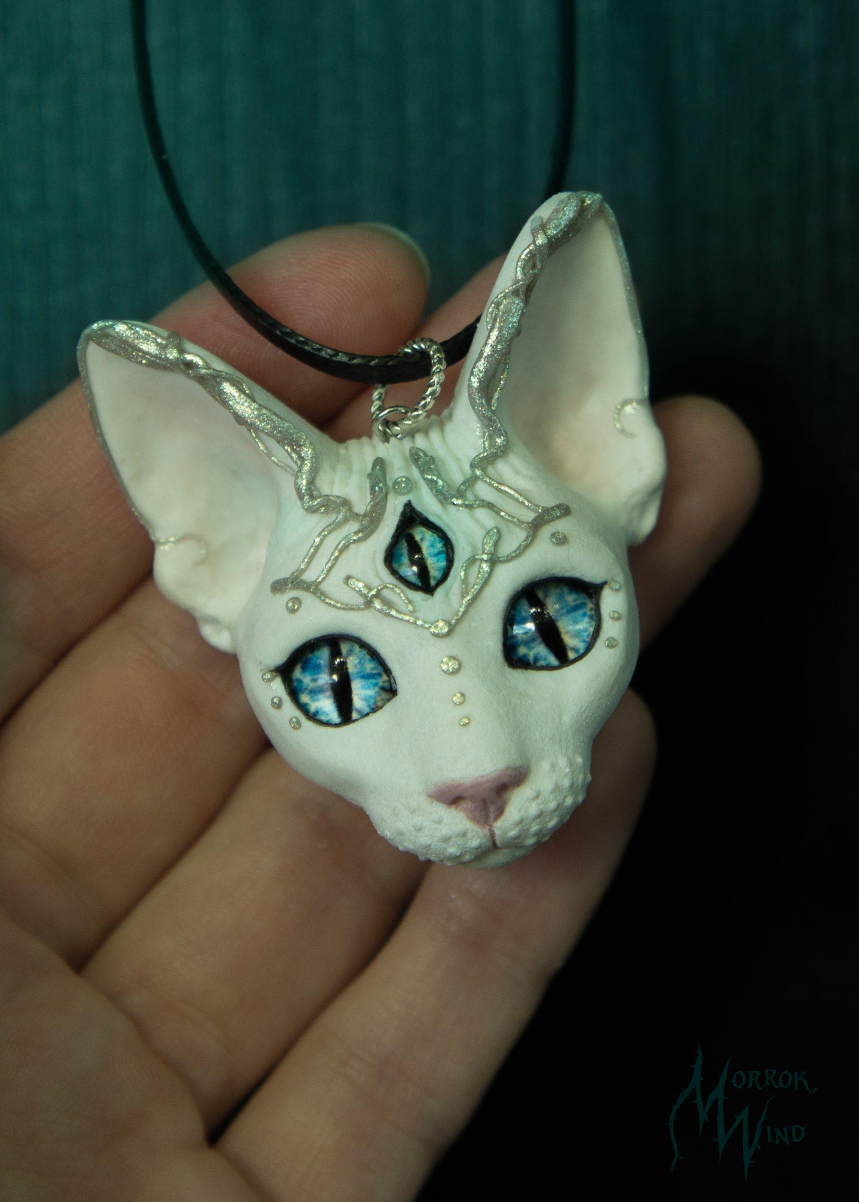 white cat Sphynx cat third eye mystic necklace blue eyes