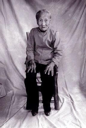 """Huang Sheng-pai: """"My mother started binding mine (feet) when I was eight years old. I'm 93 now...  I don't remember if I suffered through the process or not. But after I started binding I no longer went out of the house. It was neither proper or allowed. I just stayed home and did the cooking for the family ... I have been doing that ever since. I have never gone outside my house for at least 70 years! I have never had much problem getting around on my feet, just being in the house and all."""""""