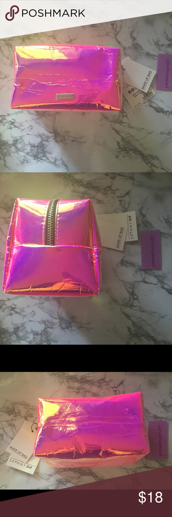 Skinnydip Hot Pink Holo travel makeup bag This is a