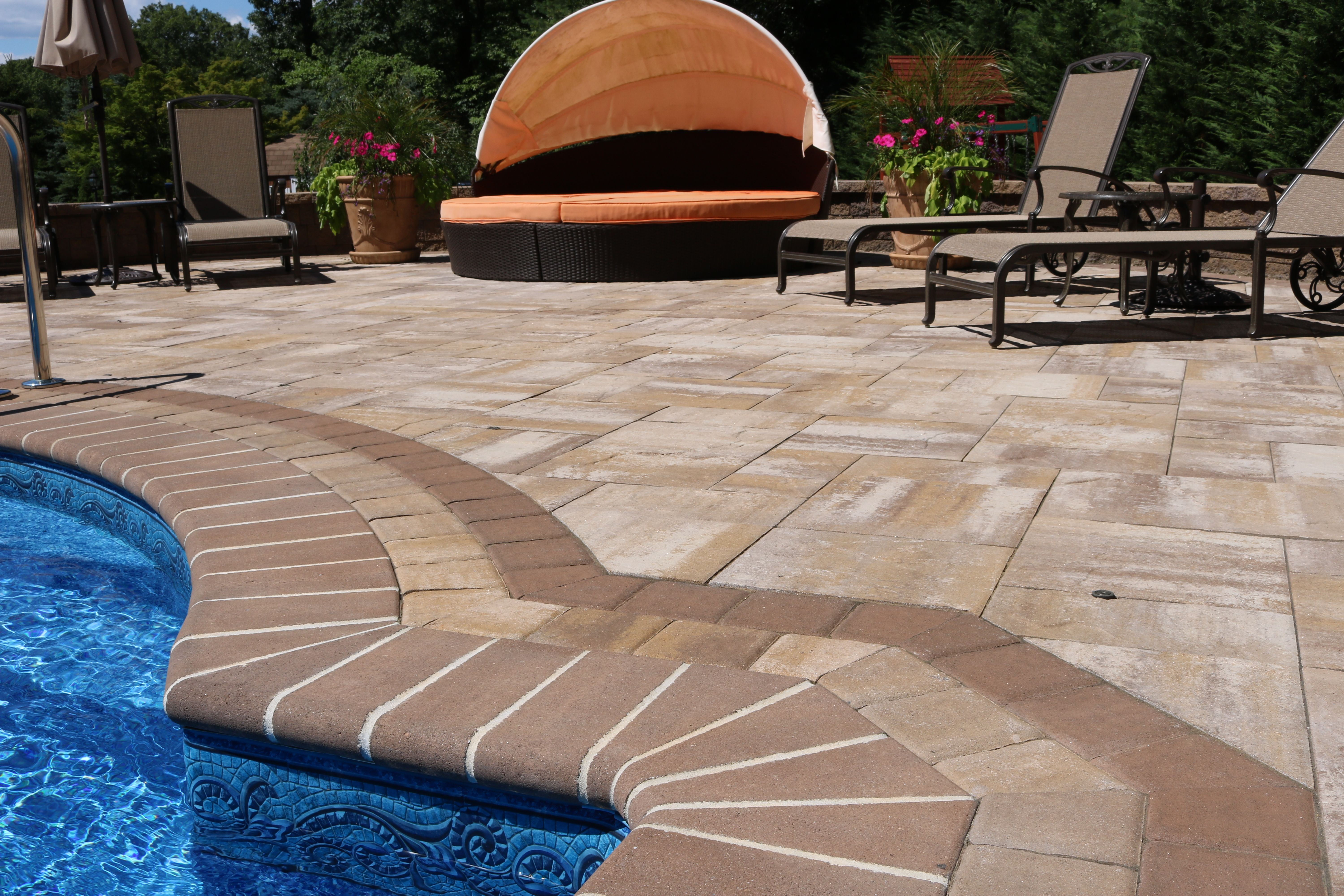 Border Your Pool With Beautiful Pavers This Patio Features Cambridge Pavingstones Armortec In