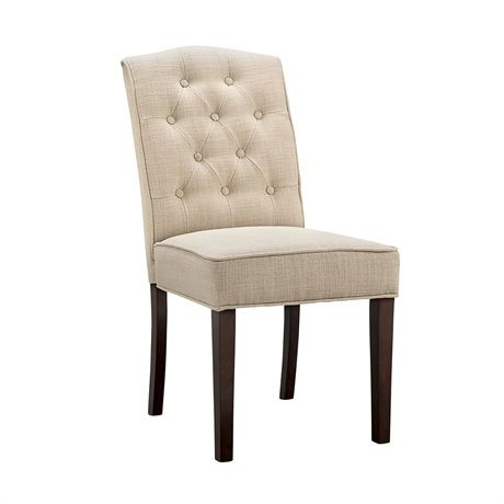 Indulge in the classic traditional design of this sophisticated dining chair that boats deep tufts for added grandeur.