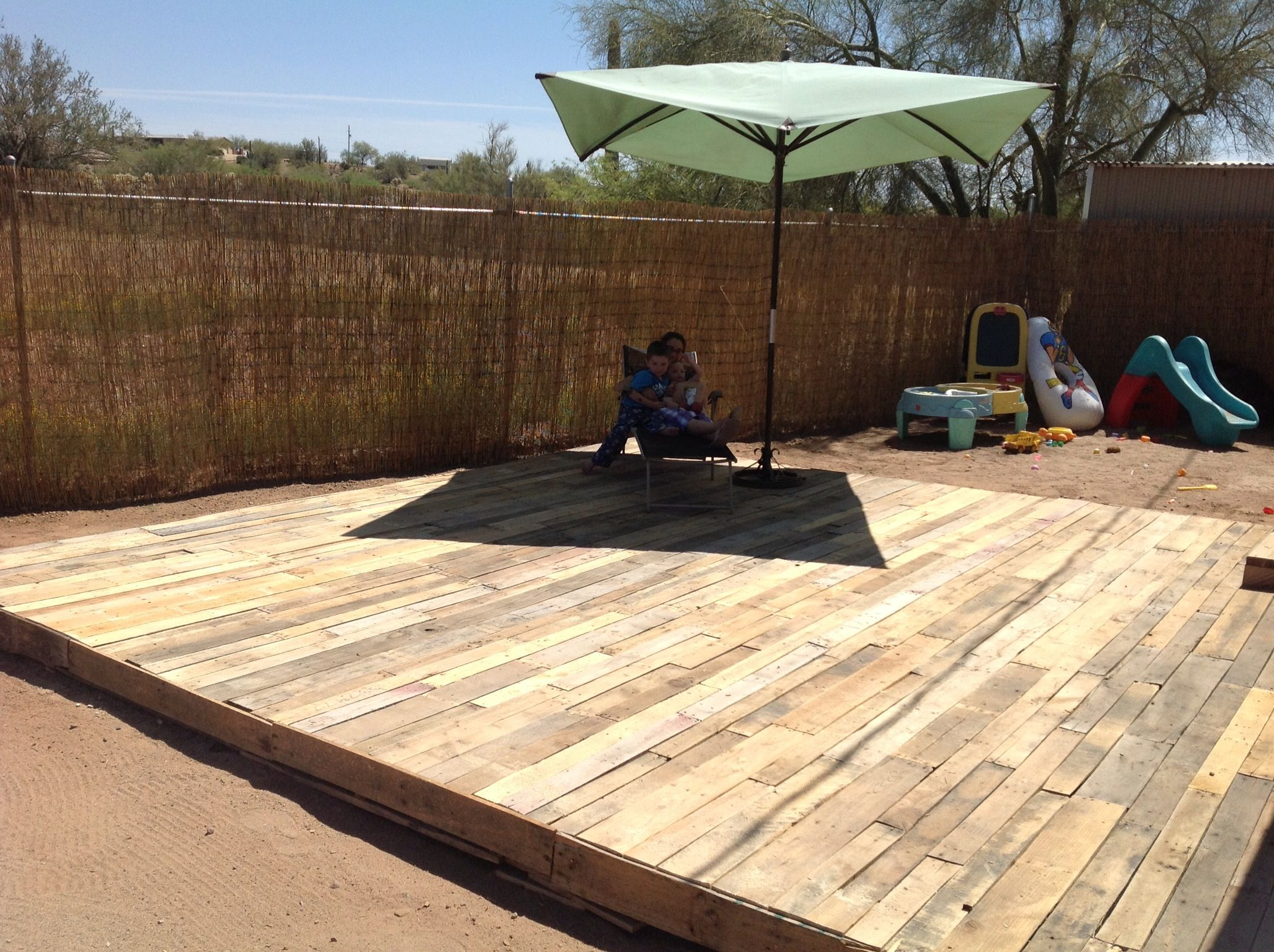 Wood pallet deck total cost 7 for saw blades on the for Pallet outdoor flooring