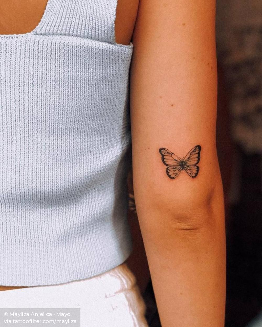 Photo of Butterfly tattoo on the back of the right arm.