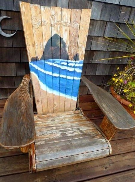 Rustic Adirondack chair painted with a Cannon beach scene, Oregon.