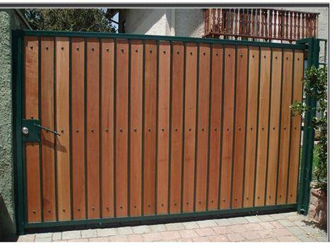 Resultado de imagem para portones de madera portones for Puertas de madera con herreria