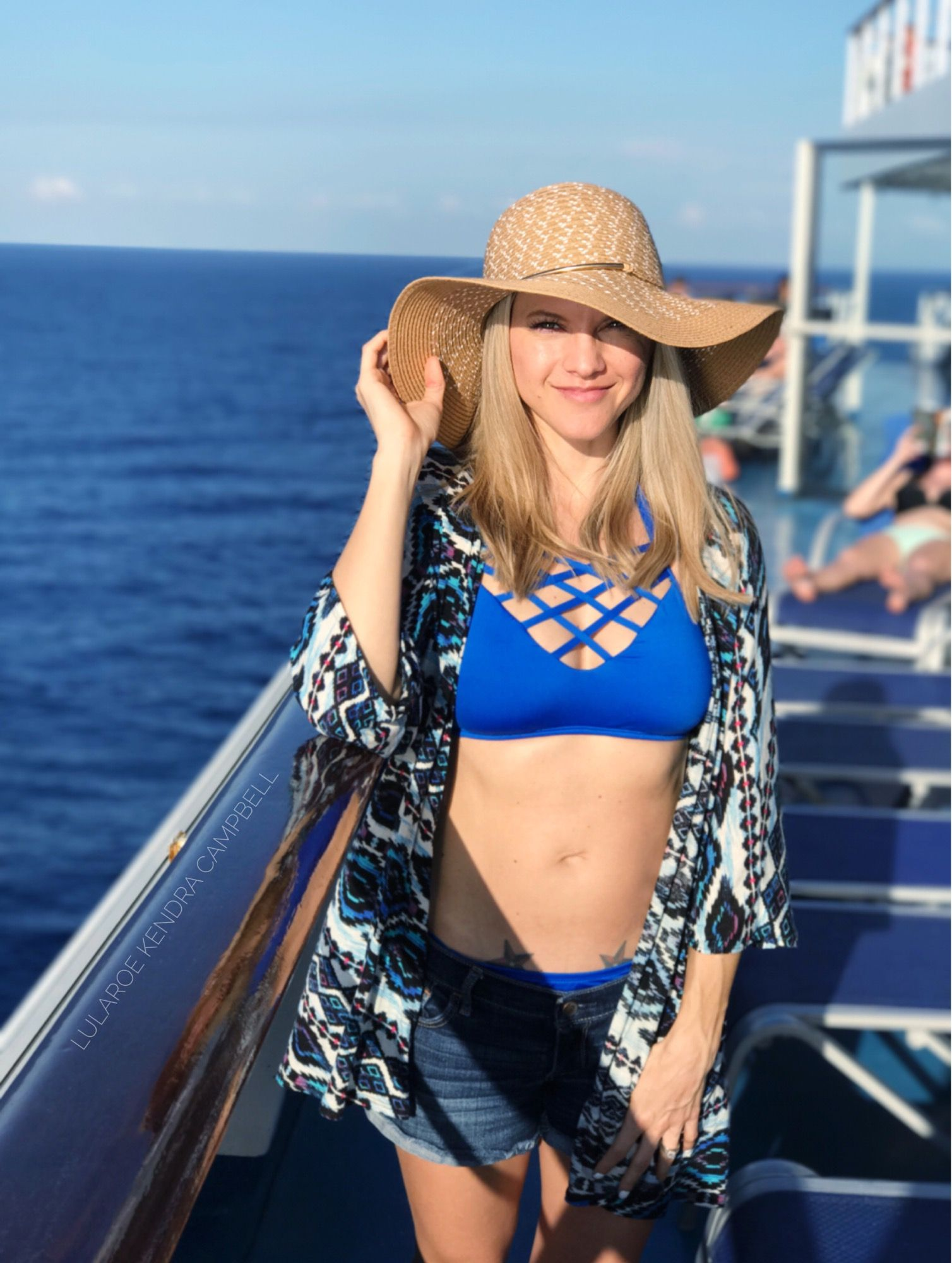 LuLaRoe cruise style: wearing a Lindsay kimono as a swimsuit coverup! Click to shop