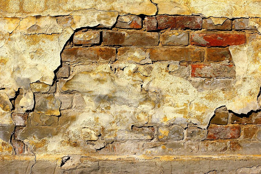 exposed brick walls in an old building | ... cracked and broken ...