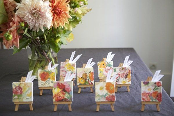 Project Styling and Photos By: Jordan Ferney of Oh Happy Day    Give your guests a mini masterpiece! This mini canvas and easel concept would be a wonderful escort card idea or even work well for a place setting.        Materials:  For this you'll need mini easels and mini canvases. I found a great cheap source right here at Blick. It's $1 for each canvas and $2 for each easel.        This project would be especially id...