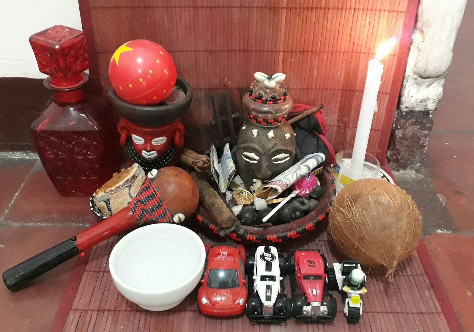 Elegba Elegua S Shrine With Toys Sweets And Maracas As Elegua Is Often Seen As A Boy In Cuba Religión Yoruba Ofrendas A Elegua Elegua Imagenes