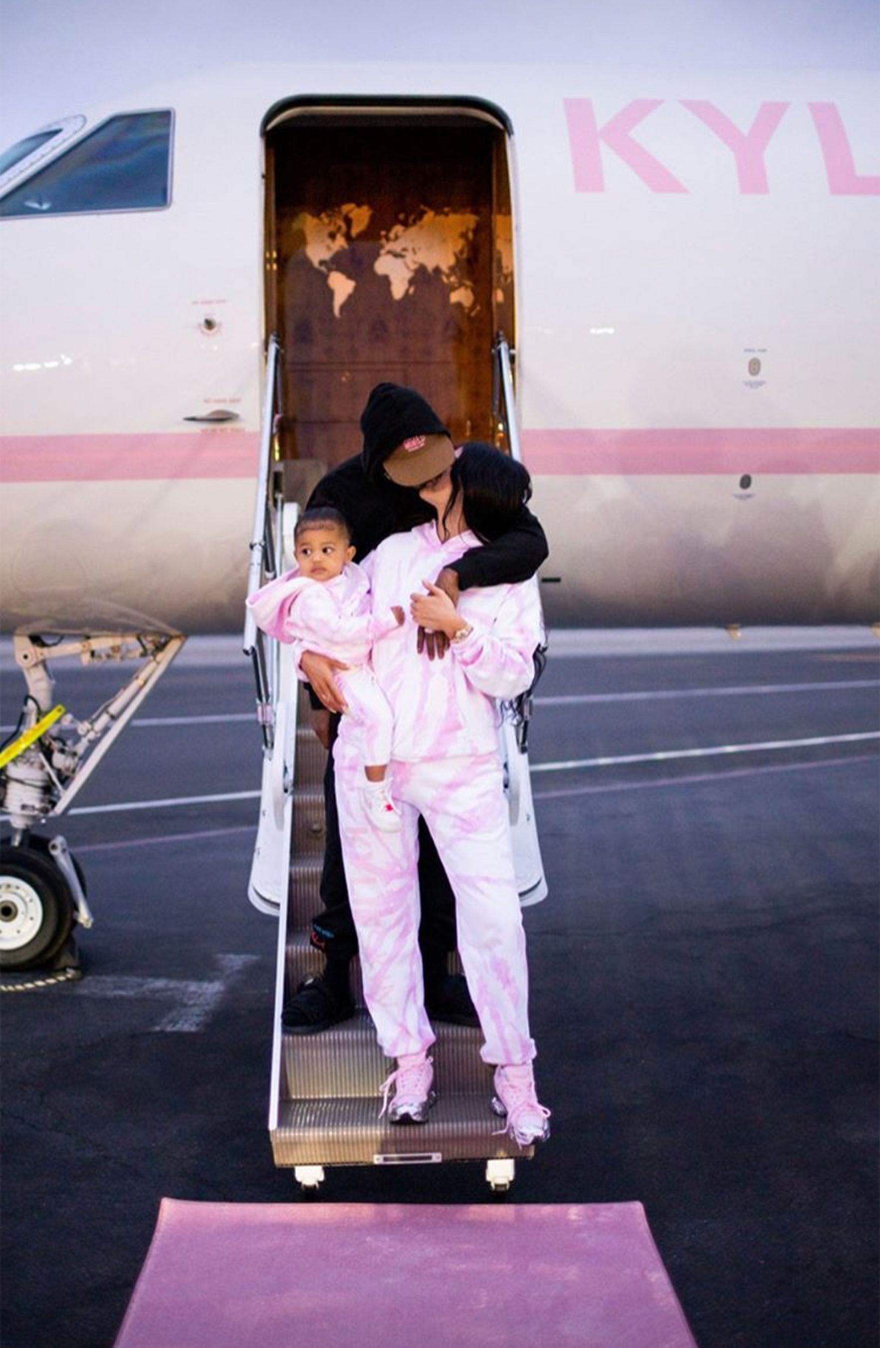 Kylie Jenner Brings Daughter Stormi Along for Kylie Skin Launch Trip — and Gets a Kiss from Boyfriend Travis Scott