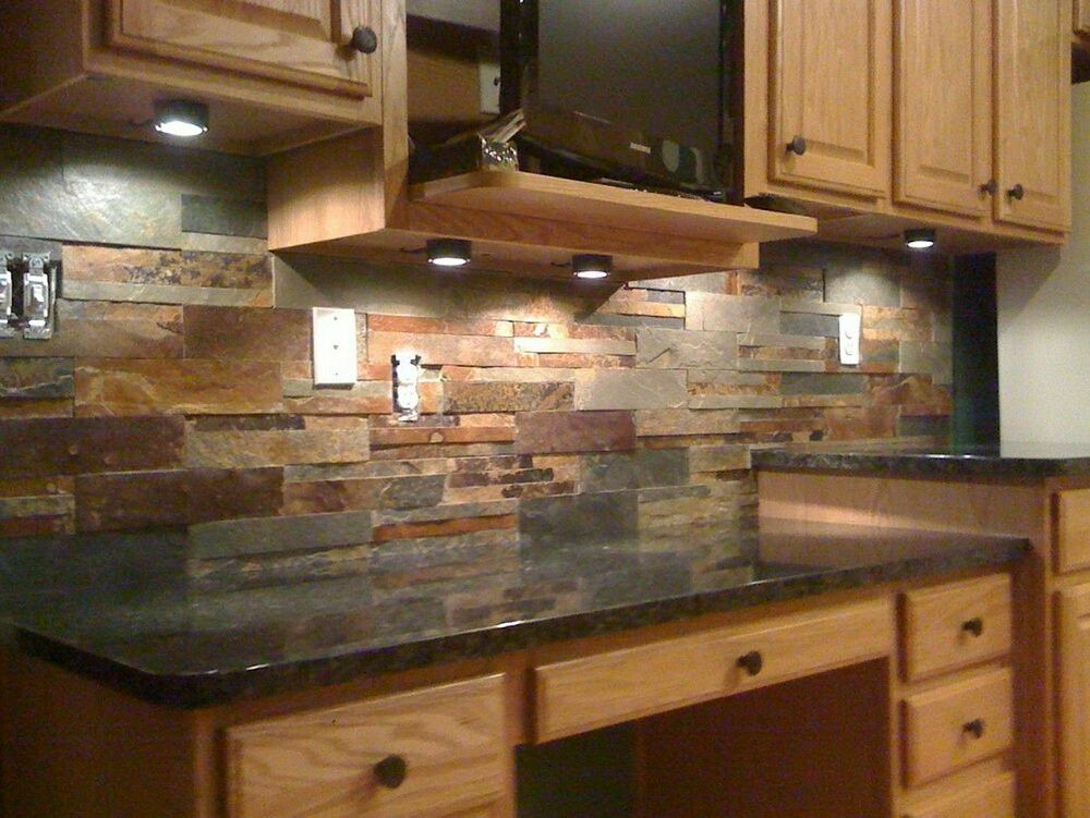 Stone Backsplash The Colors Are Right On This Black Countertop