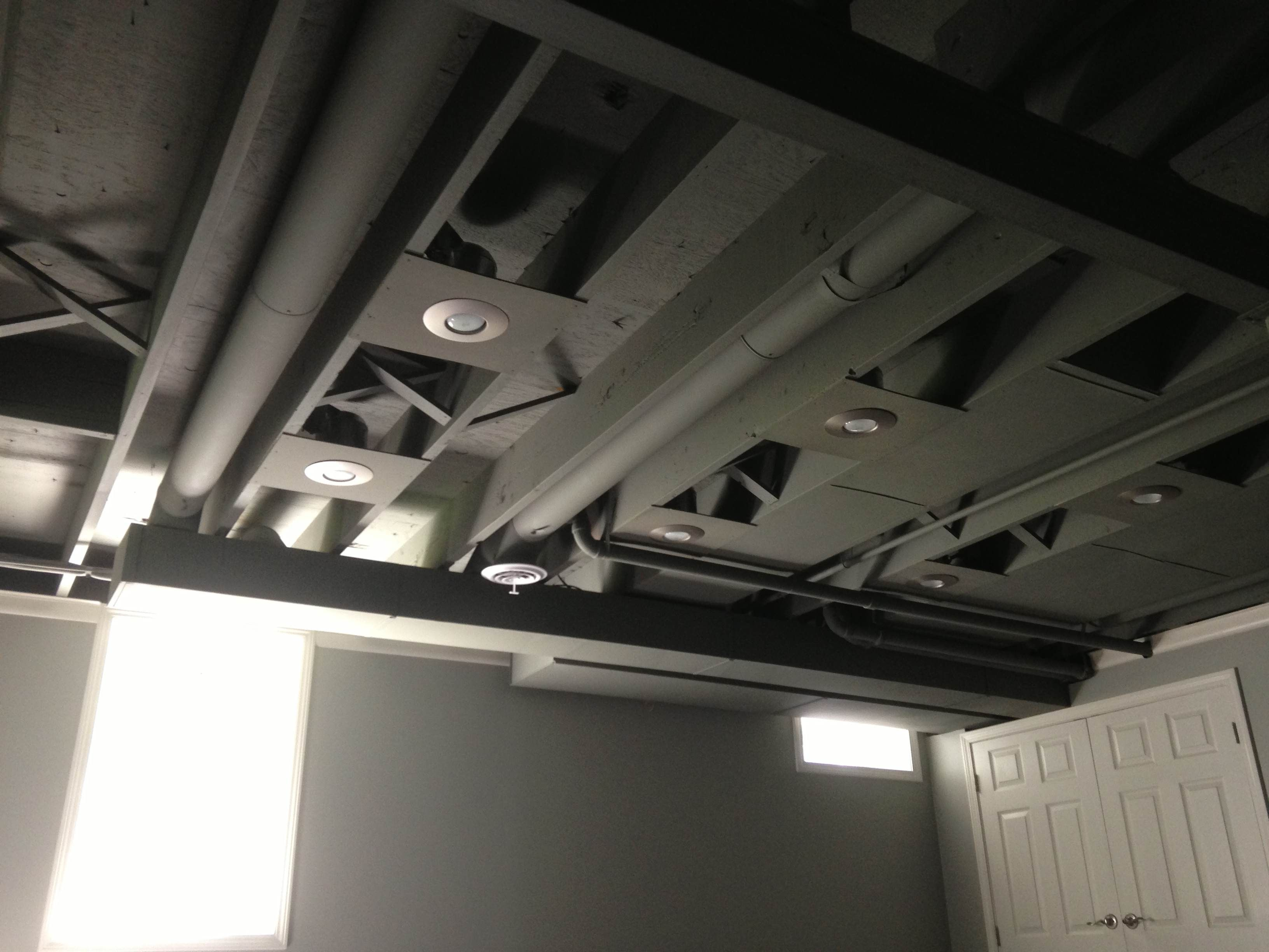 Exposed Painted Basement Ceiling Spray Painted Would Look Cool In White Or A Bright Color Basement Ceiling Painted Low Ceiling Basement Basement Lighting