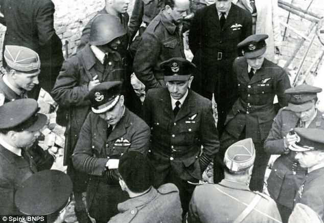 Air Cdre Sismore pictured top right with Group Captain Robert Bateson (left foreground) an...