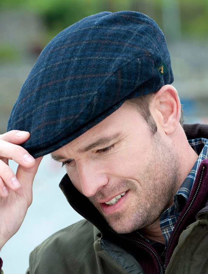 256b1e3651a The Aran Sweater market recommends you browse our selection of Irish tweed  flat caps and hats such as our Navy tartan flat cap.