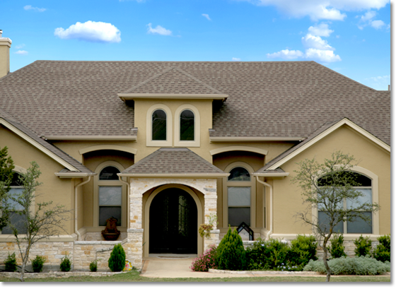 Stucco and stone home with light color stucco wrapped windows ...