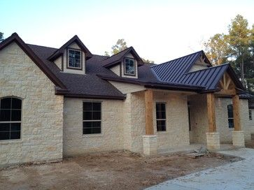Texas Ranch House Style With Stone Metal Roof Accent And Cedar