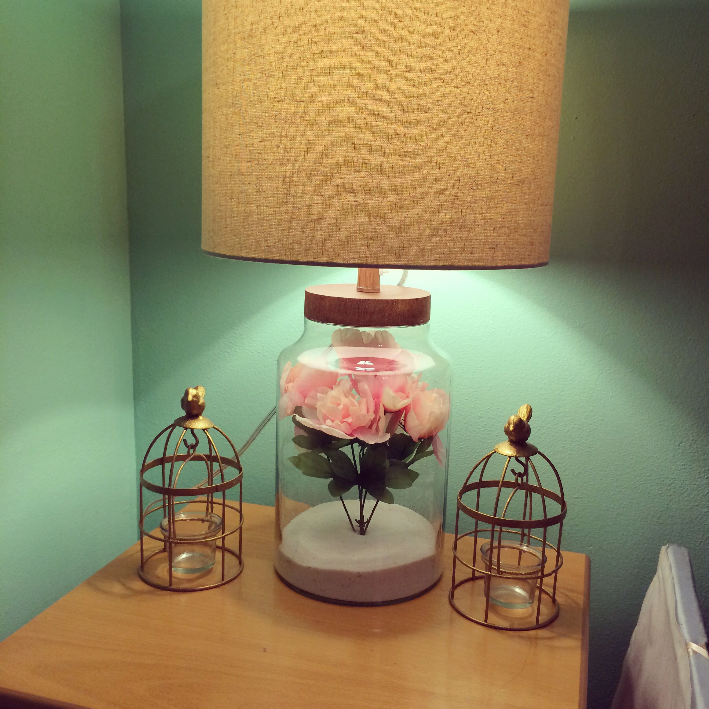 Fillable lamp from target filled with sand & fake flowers.   For my ...