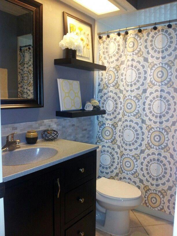 Photo of Grey and yellow bathroom – love the shower curtain. Spare bath or half bath mayb…