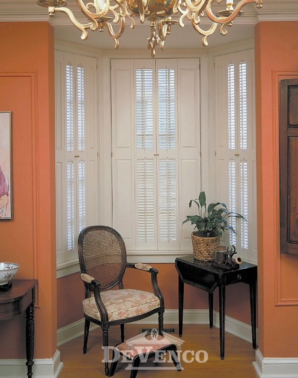 The brownstone shutters in the bay window above are - Raised panel interior window shutters ...