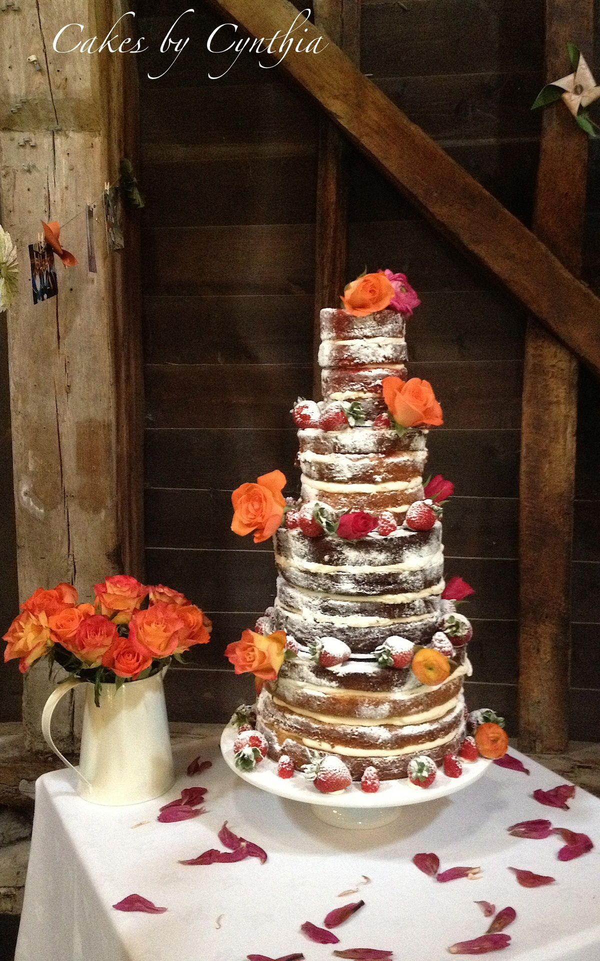 rustic naked cake with fresh fruit and coral roses. wedding cakes