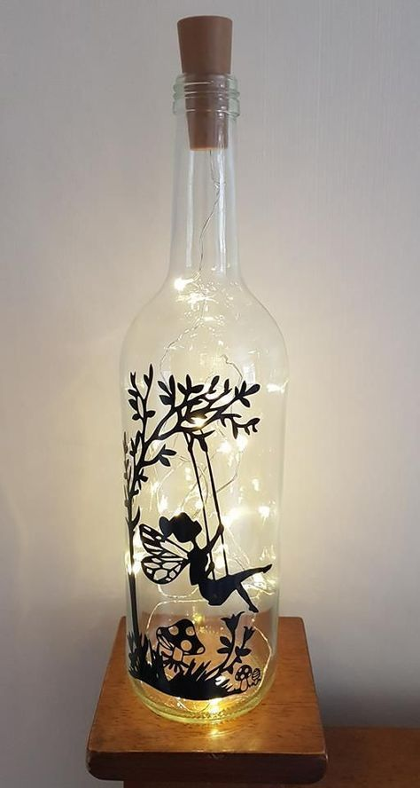 55+ Creative Wine Bottle Crafts With Lights You Want For Your Home #creativegifts