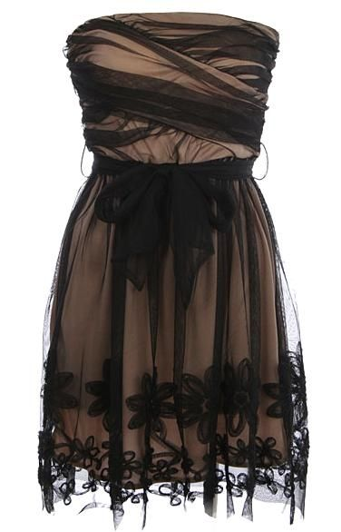 Swathed Nocturne Dress: Features a chic strapless cut with a beautiful swathed bodice, gorgeous black mesh overlay with contrast nude liner, removable black ribbon sash at waist, and intricate embroidered flower appliques surrounding the hem to finish.