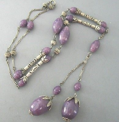 THIS GORGEOUS VINTAGE ART DECO PURPLE ART GLASS BEAD DANGLE FLAPPER NECKLACE IS 29 3/8 LONG WITH AN ADDITIONAL CENTER DROP OF 5 1/4 , THE LARGEST BEADS ARE 1 1/16 LONG, BEAUTIFUL CONDITION, ABSOLUTE