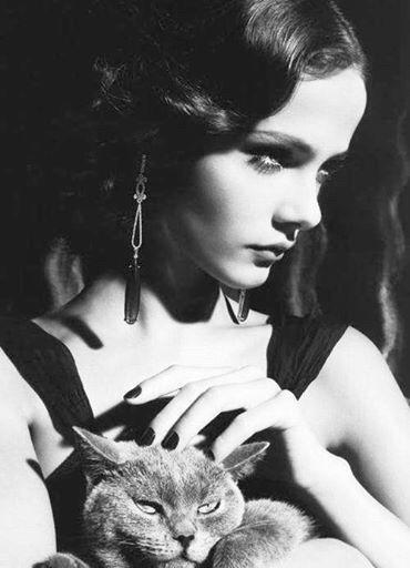 Beautiful woman, grumpy cat.