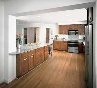 Another view--This Old House remodel which reuses Quaker Maid oak kitchen cabinets and pairs ...