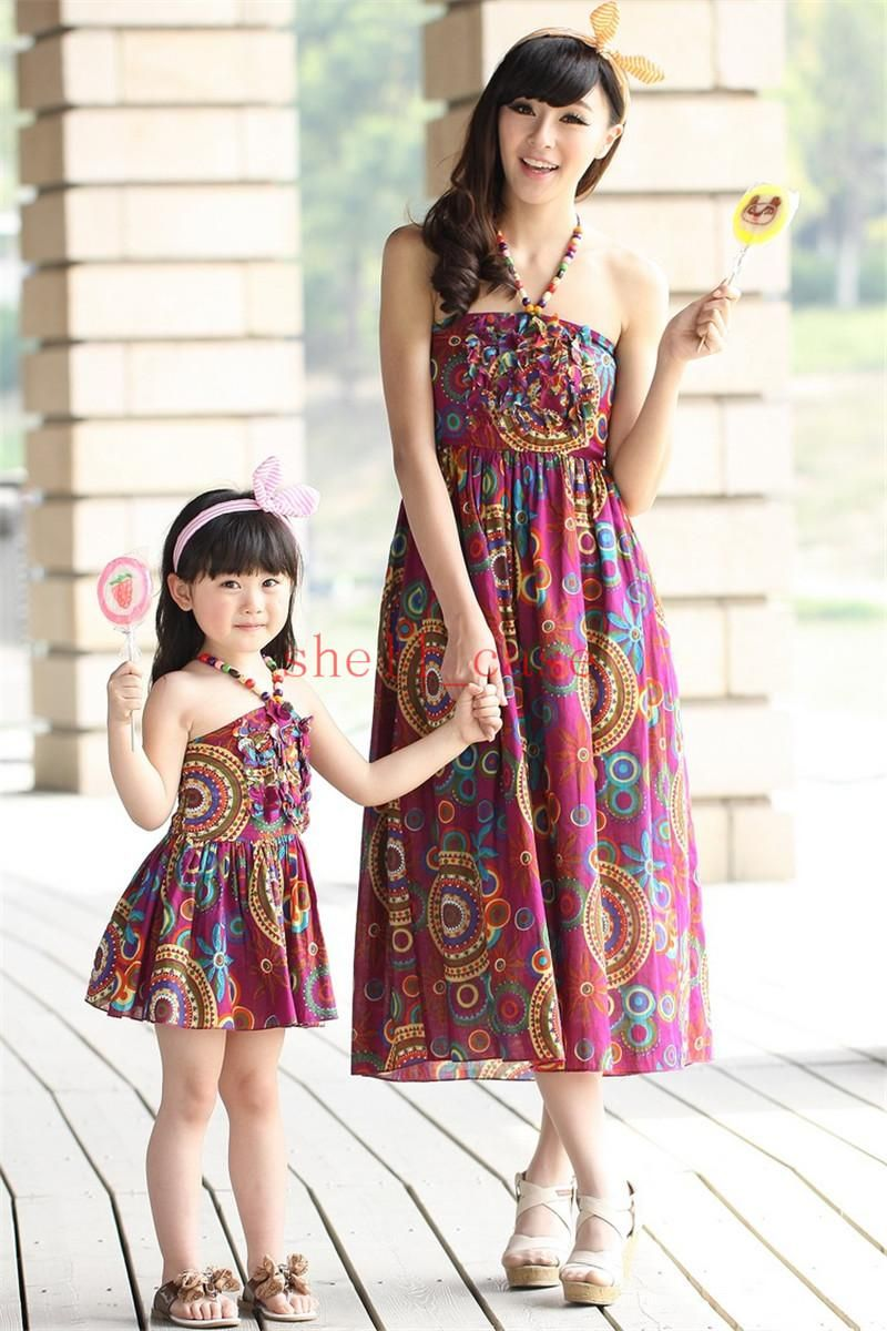 ccb4bc0ba4b Cheap Hot Summer Family Dresses Clothing Spaghetti Strap Beach Bohemia  Mother And Daughter Matching Clothes Dress Mom Baby Floral Print Maxiskit  From ...