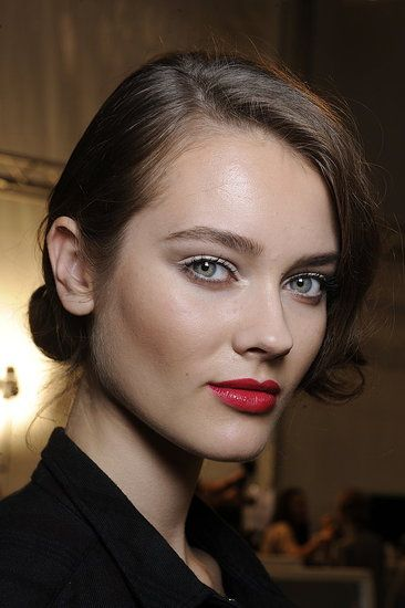 Christian Dior.  Love the white matte eyeshadow, so clean and regreshing with the red lipstick.