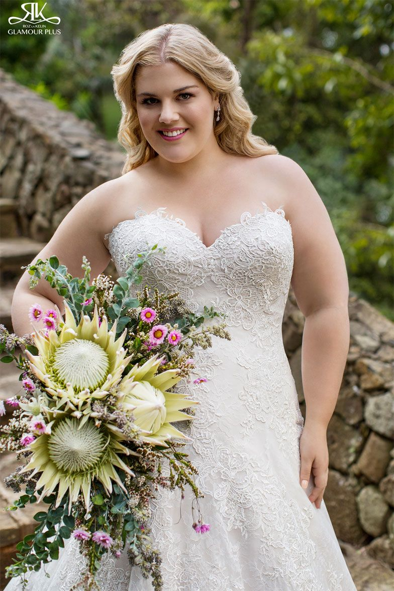 Wedding dresses for curvy brides  Classic lace Aline styling strapless gown The feature is the