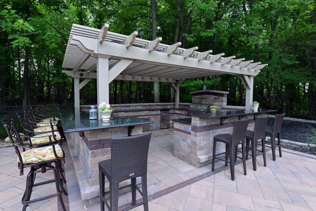 This Clay Vinyl Pergola Defines A Beautiful Outdoor Kitchen And Bar Area. Berlin  Gardens Offers Pergolas In White Or Clay Colored Vinyl That Requires Almost  ...