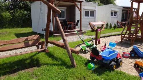 Domki Letniskowe MA-REST G?ski Offering a barbecue and children's playground, Domki Letniskowe MA-REST is located in G?ski in the West Pomerania Region, 22 km from Ko?obrzeg. Free WiFi is offered throughout the property and free private parking is available on site.