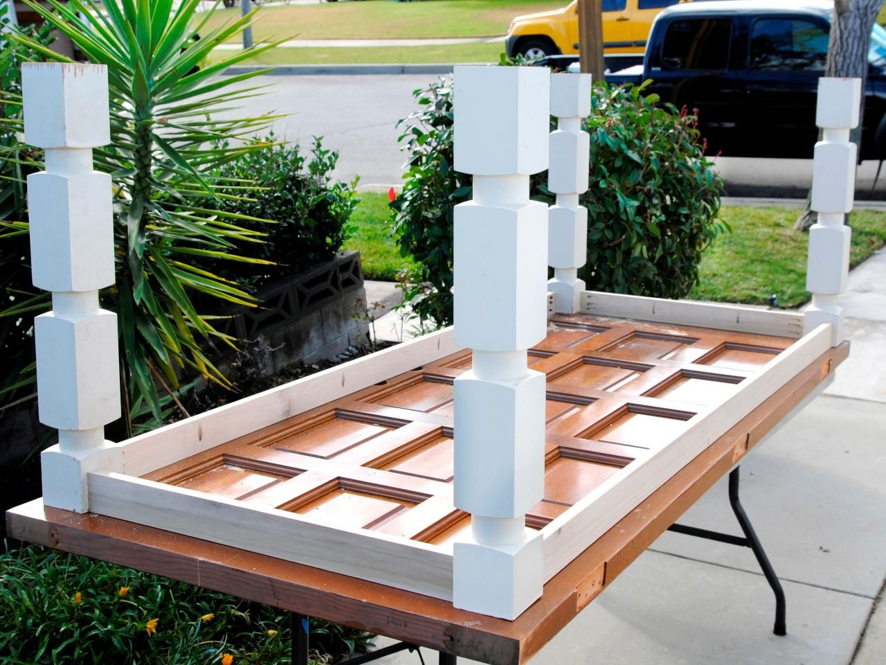 How to build a dining table from an old door and posts for How to turn an old door into a table
