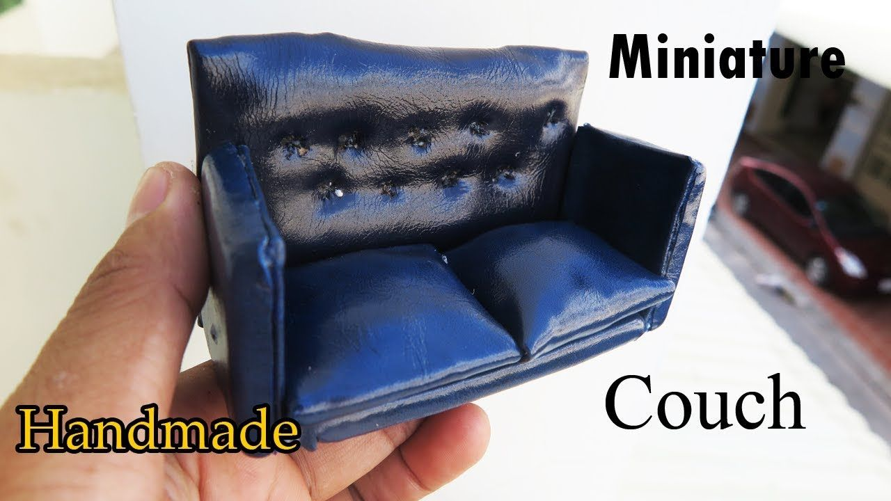 dolls stock female sitting and male miniature cnetep couch photo on