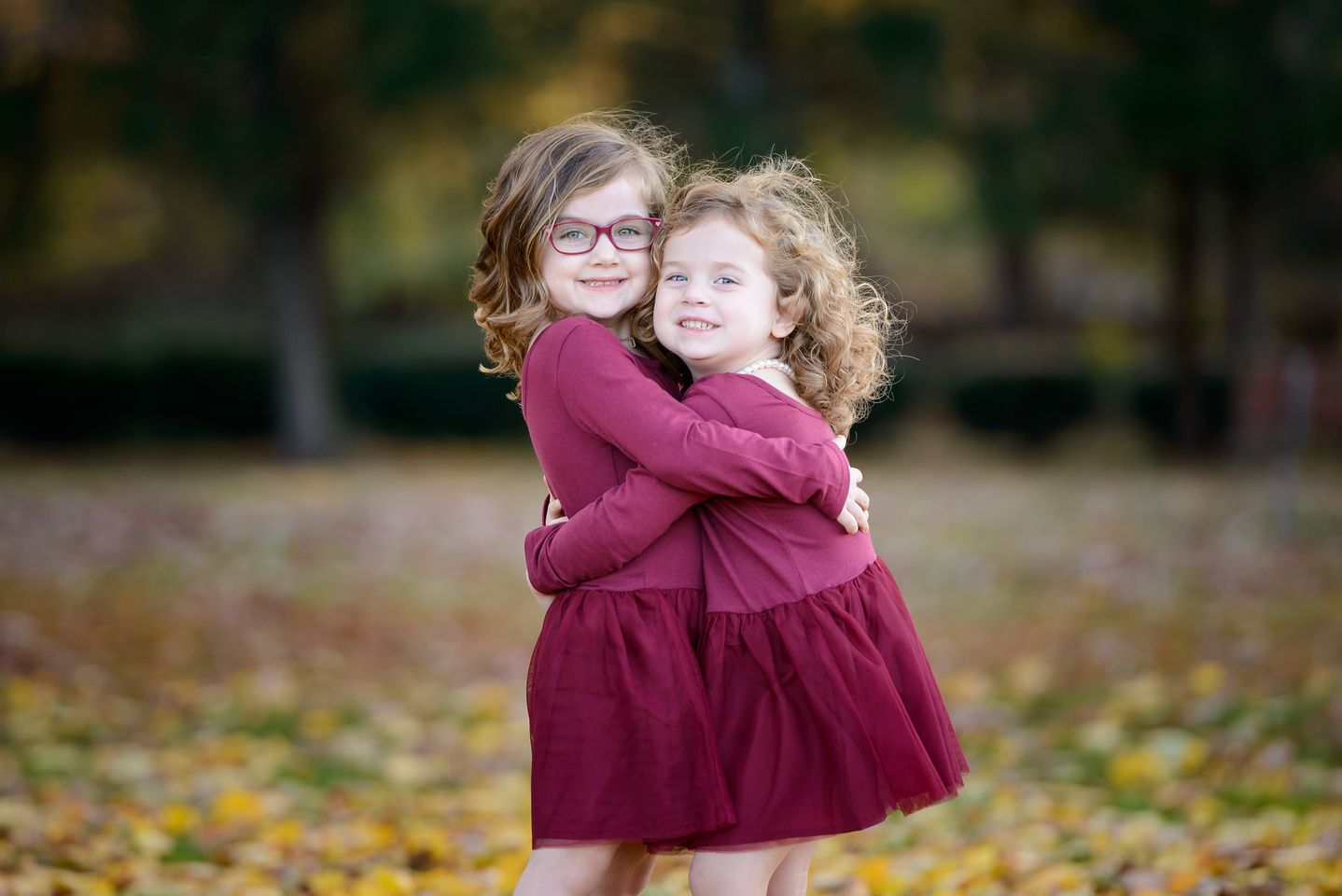 Sibling photo ideas, sibling posing, sisters, matching dresses