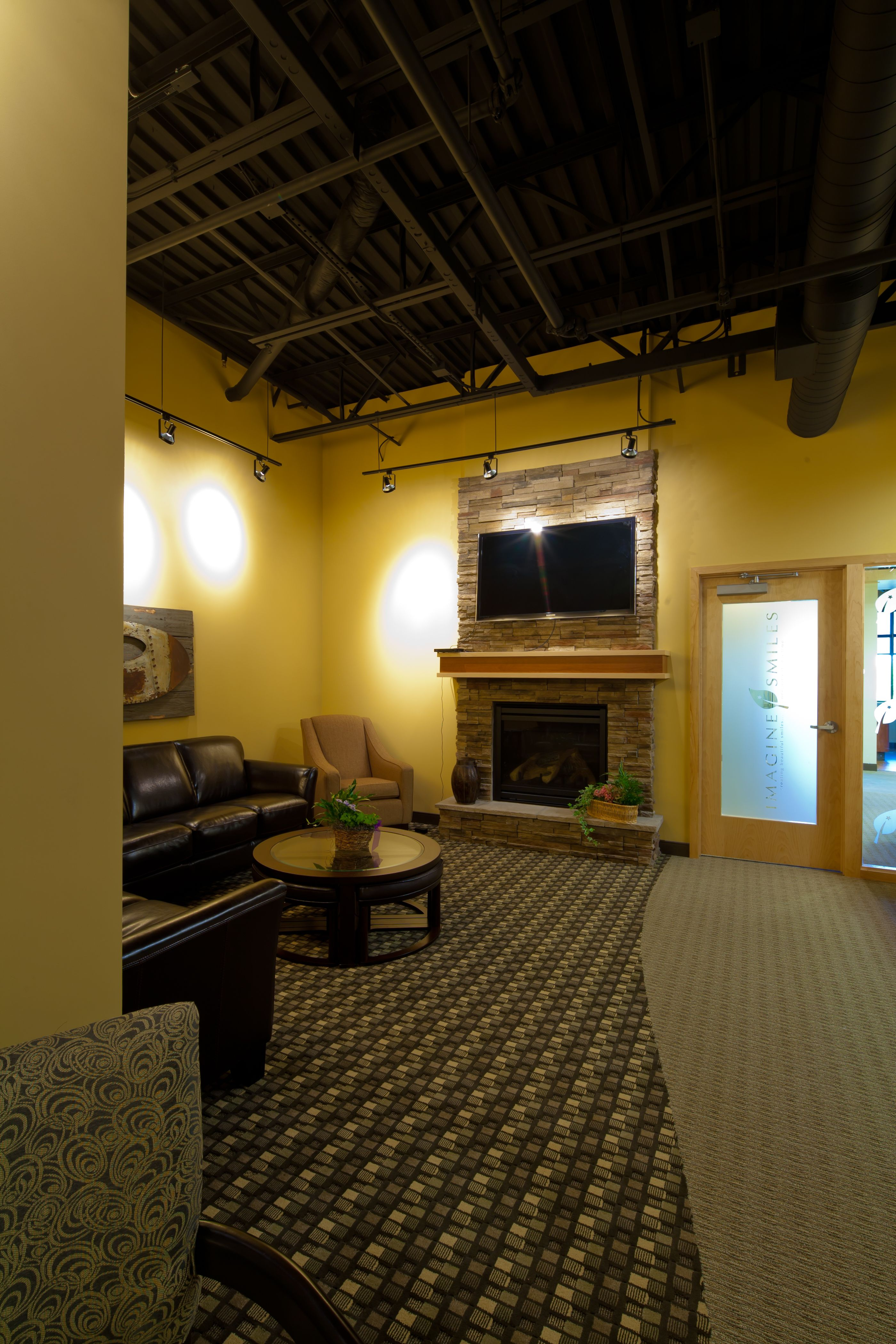 Open Stone Fireplace This Dental Office Waiting Room Is Warm And Inviting With A Stone