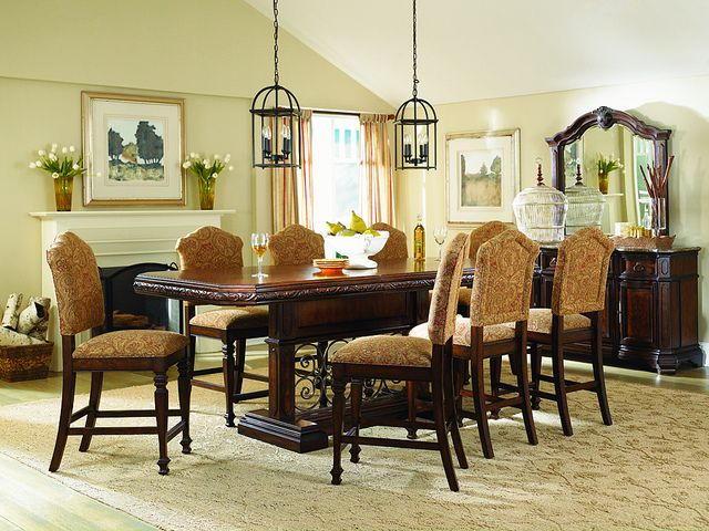 Take a look at the magnificent Calabria pub dining room set. The table features a double pedestal with metal scrollwork, clipped corners, and a carving motif that encompasses the border of the table. The chairs are fully upholstered creating a beautiful compliment to the design. The Calabria pub is guaranteed to impress. www.facebook.com/mealeysfurniture  www.twitter.com/followmealeys  www.youtube.com/mealeysfurniture