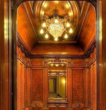 Lovely and elegant wooden paneled antique elevator with for Luxury home elevators
