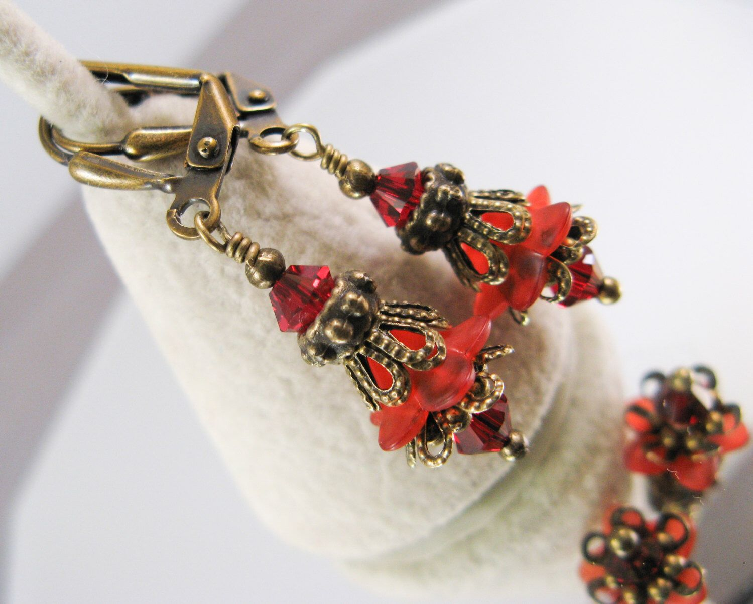 A personal favorite from my Etsy shop https://www.etsy.com/listing/93626452/new-swarovski-red-siam-crystal-vintage