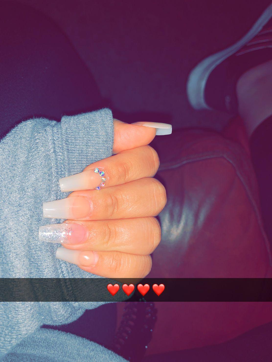 Rhinestones on index finger and half glitter on ring finger