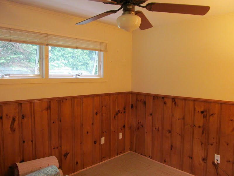 half-wall painted wood paneling treatment. certainly more of an
