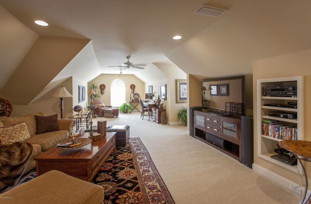 Traditional Attic With Built In Bookshelf Lifeproof Pagliuca I Color Candle Glow Texture Ceiling Fan Carpet Home Zillow Digs Living Room Furniture