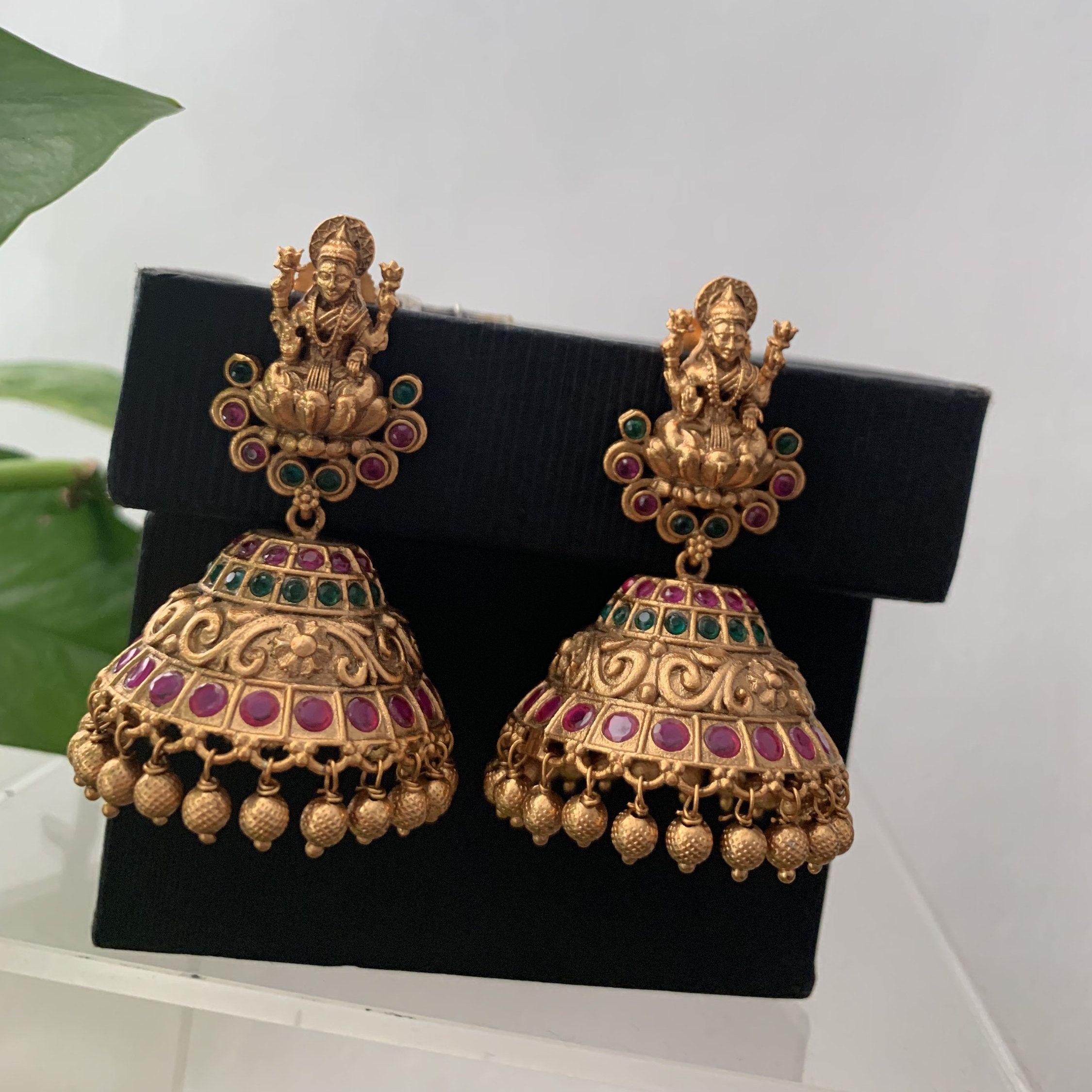 Antique gold finished rubyemerald goddess lakshmi jhumkas