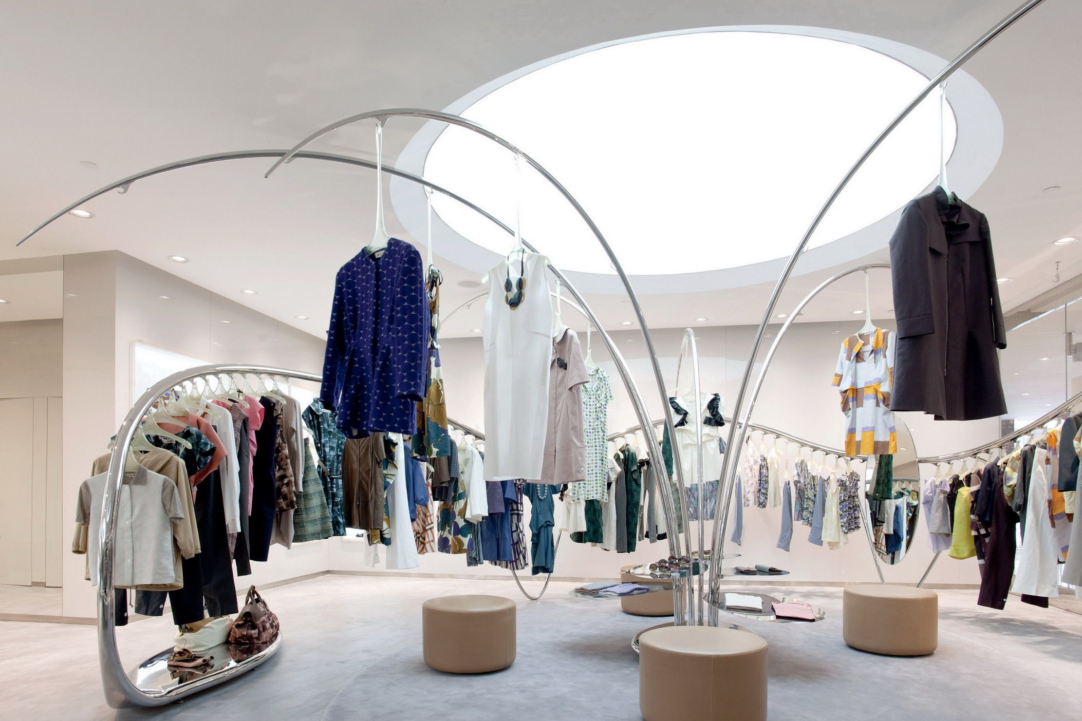 The iconic tree and flowing stainless steel rails to create flow and direction in Marni's Hangzhou Tower store.