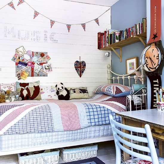 This bright and airy children's room has a Union Jack theme running throughout - from the walls to the bedding.